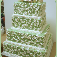 My Sage Green Wedding Cake 14,12, 10, 8 square Iced in buttercream. Royal Icing piping