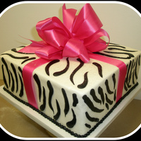 Zebra Print Cake 10 inch 4 layer white cake. Buttercream icing. The girl wanted a silk bow rather than a gumpaste.