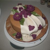 Gumpaste And Fondant Final my first fondant cake. I really need to get better at taking pictures!! Used used MMF to cover the cake. Couldn't do the wilton stuff...