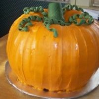 Pumpkin Cake The cake is pumpkin flavored (and pumpkin shaped, but I hope you can tell that much!!) with a delicious cream cheese icing. Accents are...