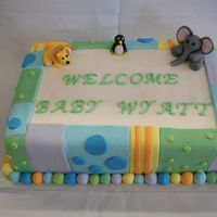 "Zoo Shower Fondant covered cake, decorated with fondant ""quilt squares"" and fondant figure zoo animals. I decorated this cake to match the..."