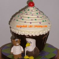 Giant Cupcake For Wedding Made this for my friend, a Canadian chef marrying his American restaurant hostess wife. He asked me to make him as a beaver and her as an...