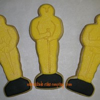 Oscar Statue Cookies   Made 275 of these for an Academy Award Gala tonight. Borrowed the cutter from a friend...thanks Lisa!!