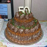 Ultimate Chocolate Fortress Cake Chocolate cake, chocolate buttercream icing and filling. Chocolate covered pretzel rods and strawberries. 50 is made out of chocolate as...