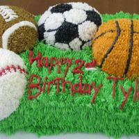 Sports Cake This cake is all buttercream icing. Took forever to do and my hand is aching!