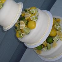 Lemons And Limes 3 tier white cake with lemon and buttercream filling, the brides theme was of course, lemons and limes, and she gave out lemon and...