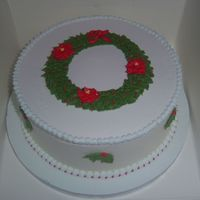 Christmas Wreath Fruit Cake covered in marzipan and RI, with RI wreath and poinsettias