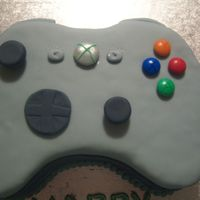 Xbox Control Chocolate cake covered in sugarpaste with sugapaste and M&M details.