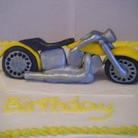 Motorcycle Cake Sheet cake with buttercreme icing. Motorcycle is MMF painted with metallic edible paint.