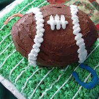 2007-Superbowl my first football cake (I need practice) I used my egg pan for the football.I had alot of problems shaping