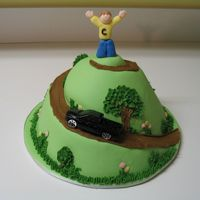 King Of The Hill Birthday Cake This was for my brother, who is very interested in environmental work, running, and his new truck. Decorations are in fondant, and the...