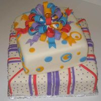 "Present Cake This was my first time using gumpaste and doing a bow. Next time I don't think I'll use white ""glue"" for the bow, but..."