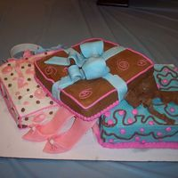 Birthday Presents I am just startindg at this. My first attempt with fondant accents. It was for my sister, she loved t.One cake was vanilla with blueberry...