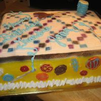 Quilting yellow butter cake, bc icing, chocolate buttons, needles, and scissors. spool of thread is a mashmallow covered in bc w/ chocolate top and...