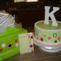 Matching Cake And Invitation  4in high 11in wide. Buttercream with fondant accents. Topper is the letter K in wood I picked up from the craft store. I matched my gift to...
