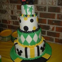 Jamaican And Disney Bridal Shower Cake 4in high layers 4,6,8,11. Buttercream with fondant accents. Base is covered in fondant to look like Jamaican flag. This is for a bridal...