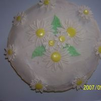 Daisy Cake This is my 1st cake using fondant & gum paste. The icing is Snow white Buttercream. All the daisies are made of gumpaste & fondant...
