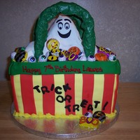 Halloween Trick Or Treat Bag yellow cake covered in fondant, RKT ghost, Chocolate handles and halloween candy