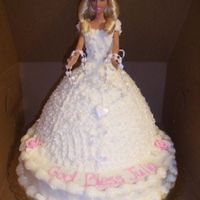 Barbie 1St Communion Cake Barbie doll in cake with rosary beads for 1st communion, yellow cake with buttercream icing