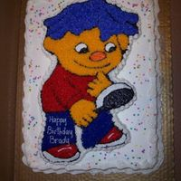 Sid The Science Kid Sid the Science Kid cut out of cake on 1/2 sheet cake