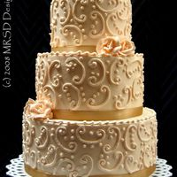 "Peach Swirls Vanilla cake with vanilla SMBC -- 10, 8, 6"" -- buttercream icing, roses, and tiny leaves -- satin ribbon. Critic Subgroup Members: I..."