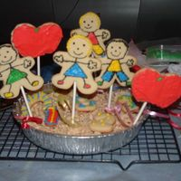 School Cookies i got the idea out of the wilton book. i just changed it alittle bit. i added #s and rice krispies to hold the sticks in place :)