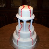 Baseball Wedding Cake I don't know who to credit the original design to - I made this to simulate a picture the couple provided. This was made for my son&#...