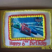Cars For Nicholas Edible image.. yellow cake with strawberry filling, buttercream icing. This was a hardf cake to do. I had to bake it twice, the first...