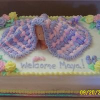 Baby Blanket... The Finished Product This is the baby shower cake I learned in class. I added the roses and fringe to the blanket, but I think that next time I will add the...