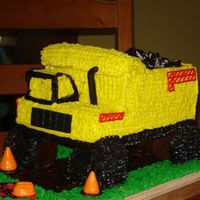 Tonka Truck  Tonak Truck birthday party! Chocolate cake covered in BC. I made one large sheet cake then cut into pieces to stack up to get the shape....