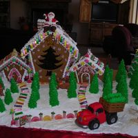 Dscn0705.jpg Santa's Tree Farm...100% edible, aside from the light bulb inside. Poured candy star, tree and trunk. Sculpted rice crispy treats for...