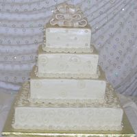 Ivory Wedding Gifts  All buttercream icing with edible pearls. Fondant bow dusted with super pearl dust. I am sad to say that the bride was unhappy with this...