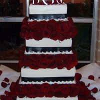 Black/white And Roses  All buttercream with satin ribbon. Thank goodness I took another cake friend with me to put all the fresh roses in between the pillars...it...