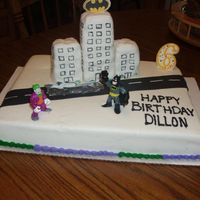 Batman This is for my grandson's 6th birthday. I wasn't happy with the way it turned out, my 1st try at covering rice krispie treats,...
