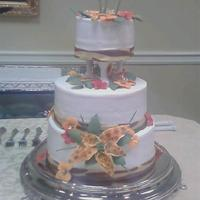 Tiger Lily Cake This is a cake I made for a dear christian lady who is a wonderful friend for her 80th birthday. I copied the flowers off of the napkins...