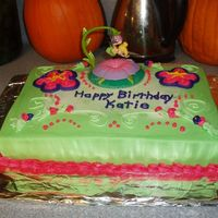 Tinker Bell White cake with BC icing. Tinker Bell cake topper in the middle.