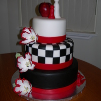 "Twilight Series 12"" ,9"", and 6"" cakes covered in fondant and decorated with sugar flowers, fondant ribbon, fondant chess peices, and a real..."