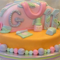 Purse Cake Purse cake and all accessories made with fondant. This cake was for an 11yr old girl who wanted something feminine but classy and fun. The...