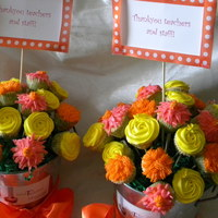 Cupcake Bouquets For Teacher Appreciation Luncheon Mini cupcakes decorated with buttercream flowers. Can anyone tell me a secret to stop the cupcake liners from peeling away from the...