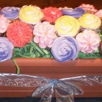 Cupcake Flower Bouquet This was my first attempt at a cupcake bouquet. I never even used these tips before, but thanks to all the flower cupcakes that came before...