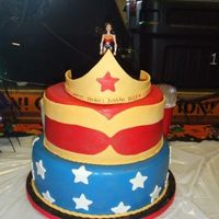 Wonderwoman Cake tiara done with gumpaste and fondant mix, figure on top was bought.