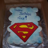 Superman Cupcakes Cupcake cake! Sky look background with a large Superman S! The kids loved it. I star tiped the S since I could not get it smooth but I...