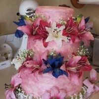Pink Passion A tropical themed reception and the bride LOVES pink. chocolate cake with MMF colored with pink and silver. You can't really see the...
