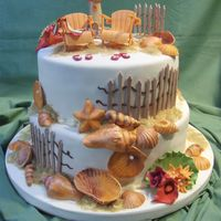 The Beach Wedding  The perfect wedding cake for that beach affair on the shores of Lake Erie in Canada.Completely edible: gumpaste shells, Adirondack chairs,...