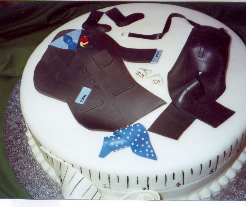 A New Suit For Dad All edible cake representing the Father's Day gift to Dad of a new suit, shirt, socks, belt, tie and cufflinks( monogrammed of course...