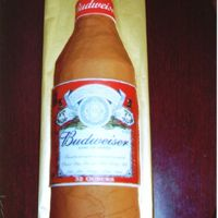 "Budweiser This was for a man's 30th birthday. I used several 6"" rounds cut in half. For the neck of the bottle I used a heating core. The..."