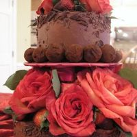 Valentine-Cake-.jpg   My first tiered cake! Chocolate cake with chocolate IMBC. Handmade truffles and hand dipped strawberries.