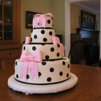 Polka Dots This was actually a graduation cake for a neighbor's daughter who saw a picture of it. It is a copy of a design done by Mary-Clee...