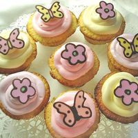 Spring Is In The Air Cupcakes decorated with chocolate butterflies and flowers...