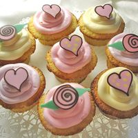 Wedding Cupcakes Wedding cupcakes decorated with chocolate hearts and roses.
